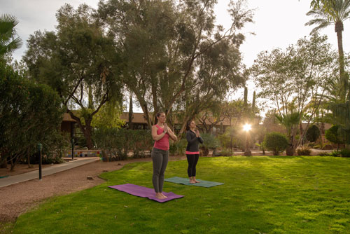 two women doing yoga outdoors - Cottonwood Tucson
