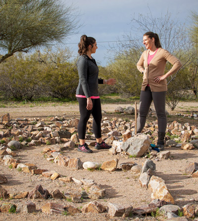 two women talking in labyrinth - Cottonwood Tucson - Experiential Therapy