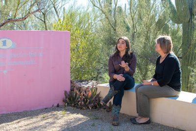two women talking in group outside - relapse prevention